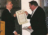 Berthold Gass, President of the International Valentin-Rathgeber-Society e.V. presents Prof. Dr. Charles Jurgensmeier SJ with the certificate